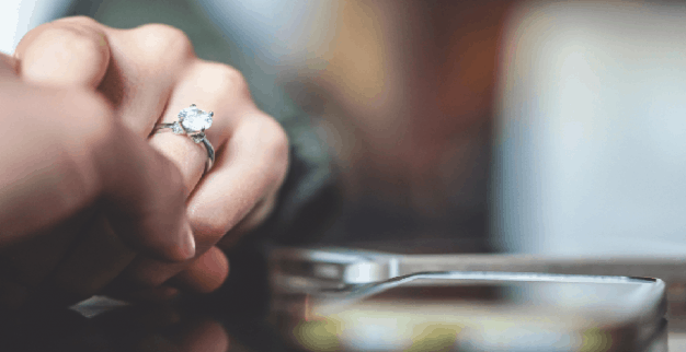 Diamond ring next to a smartphone