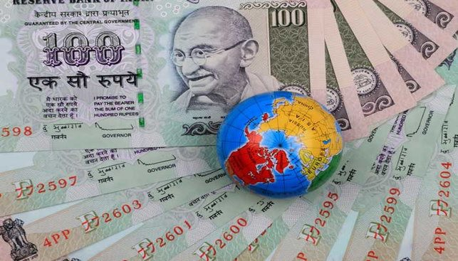 Indiam money bills and a globe