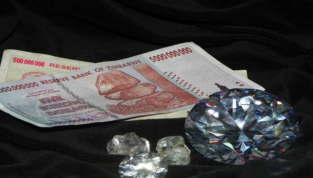 Zimbabwe money and a Rough Polishd Diamond