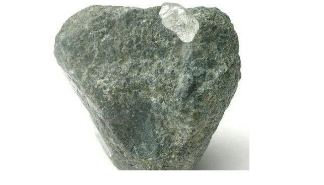Kimberlite rock with rough diamond