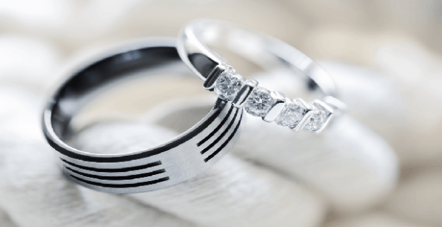 Two silver platinum and titanium diamond wedding rings