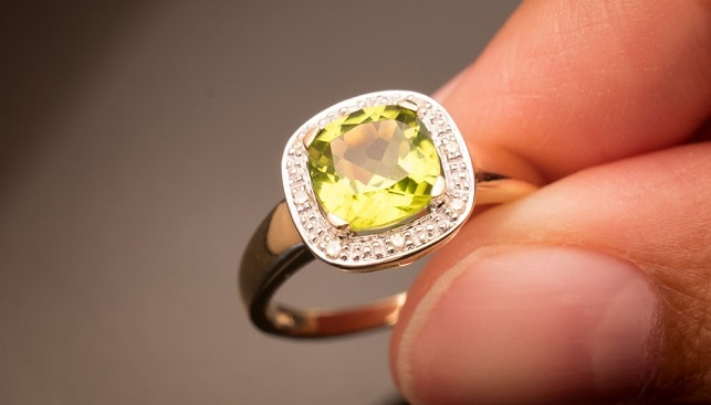 green peridot gemstone ring