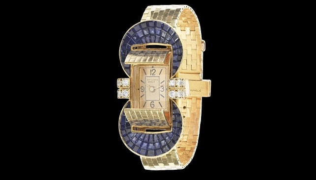 gold diamond watch by Van Cleef and Arpels